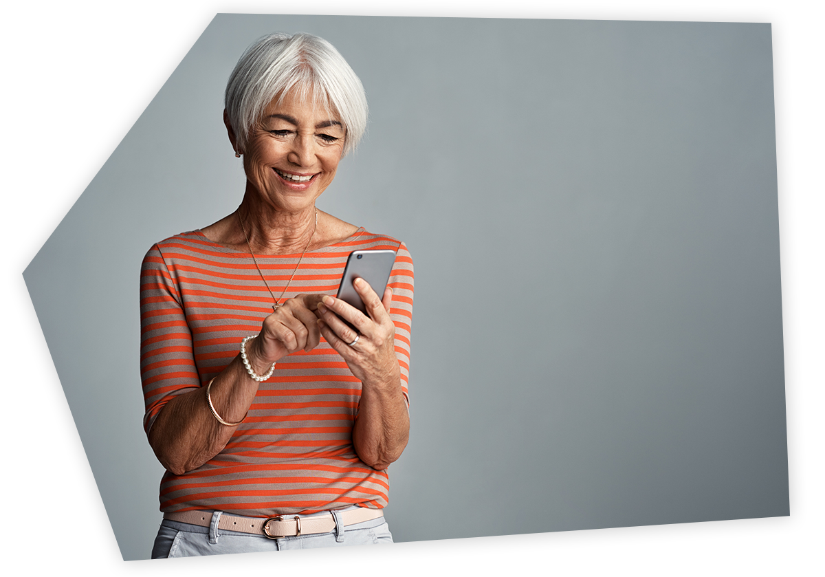 happy woman looking at personalised email on phone