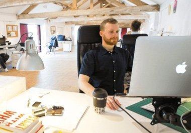 designer at screen working on email builder Creators Studio