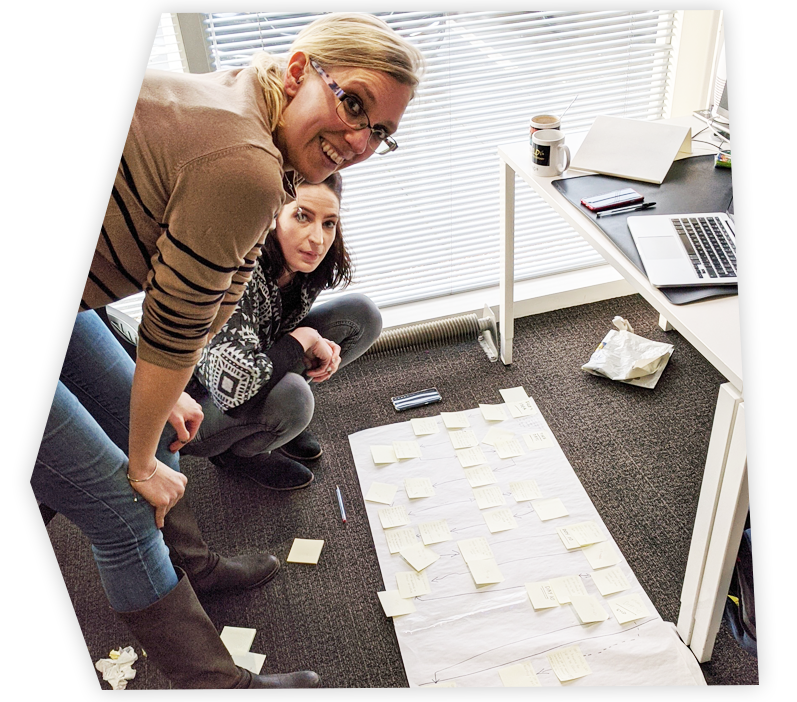 Two female CRM strategists working on a plan