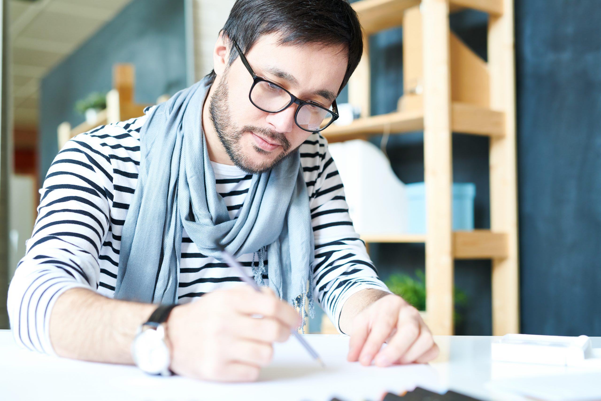 designer at desk working on widgets