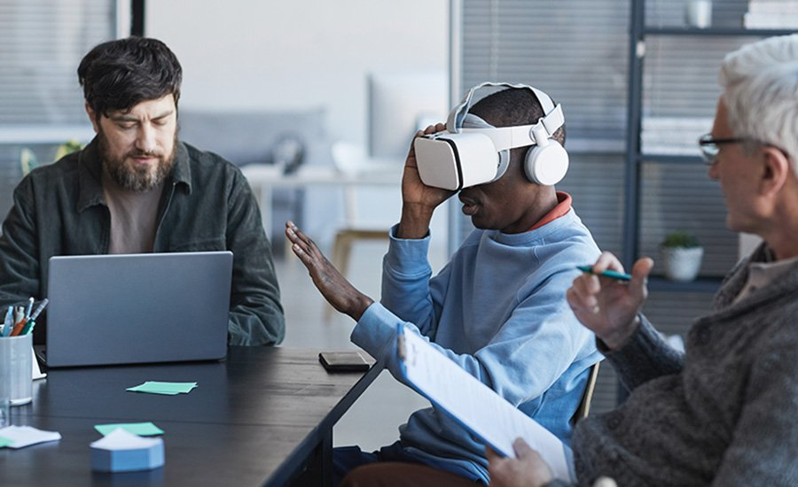 man wearing VR headset and being monitored
