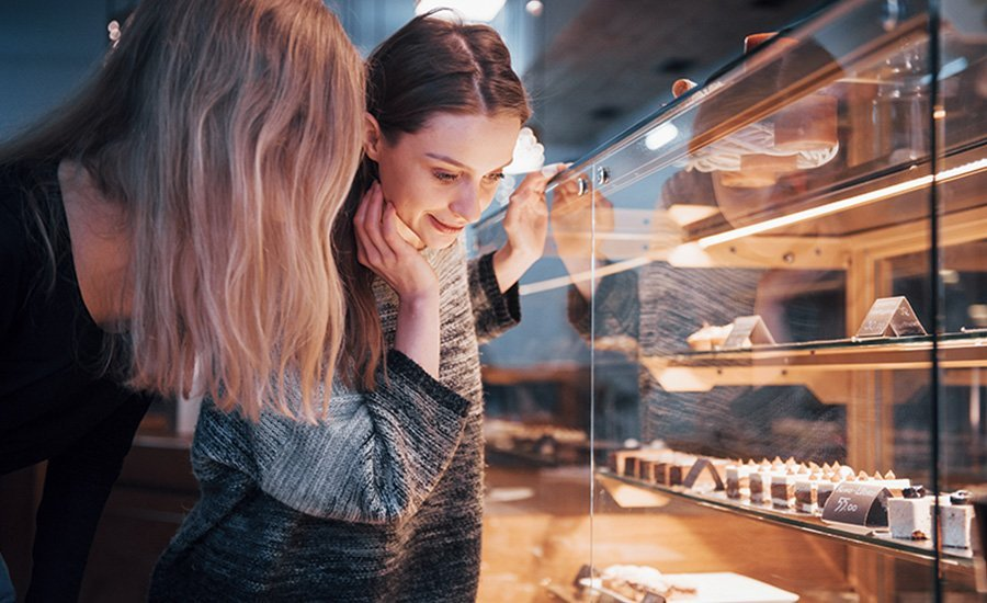 Two girls choosing delicious cakes just as attractive as good engaging emails